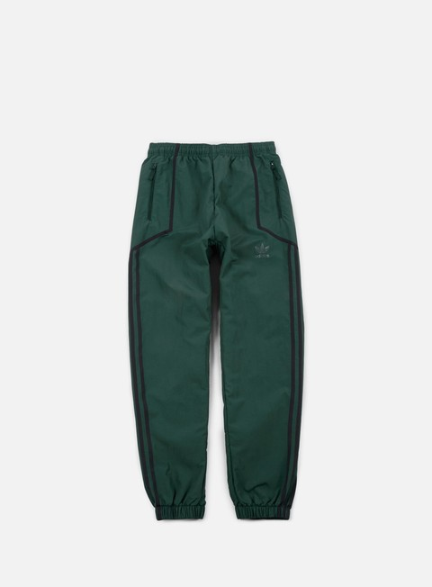 pantaloni adidas originals taped wind pant green night