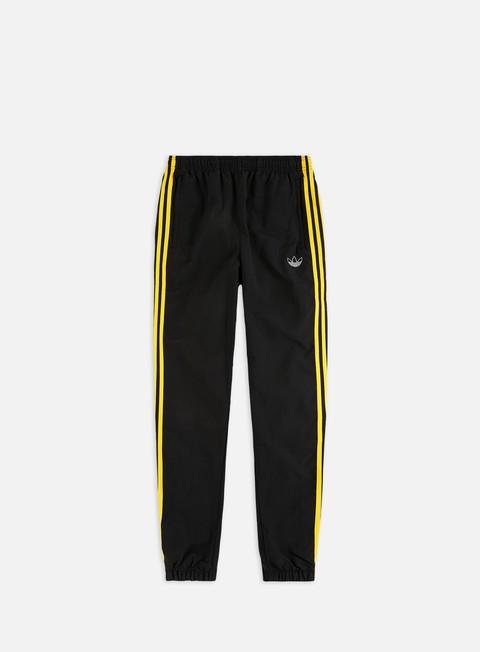 adidas pants yellow stripes