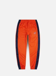 Nike - NSW HE Tearaway Pk Pant, Starfish/Midnight Navy