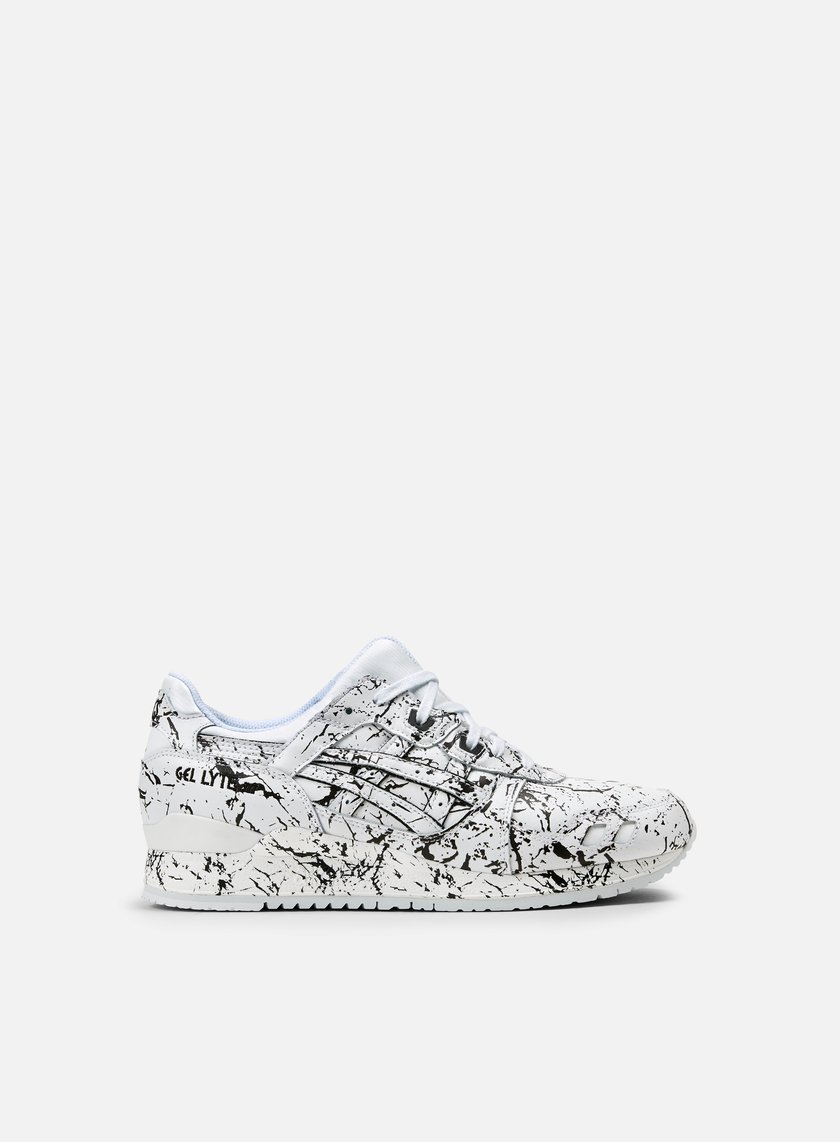 white asics with black paint